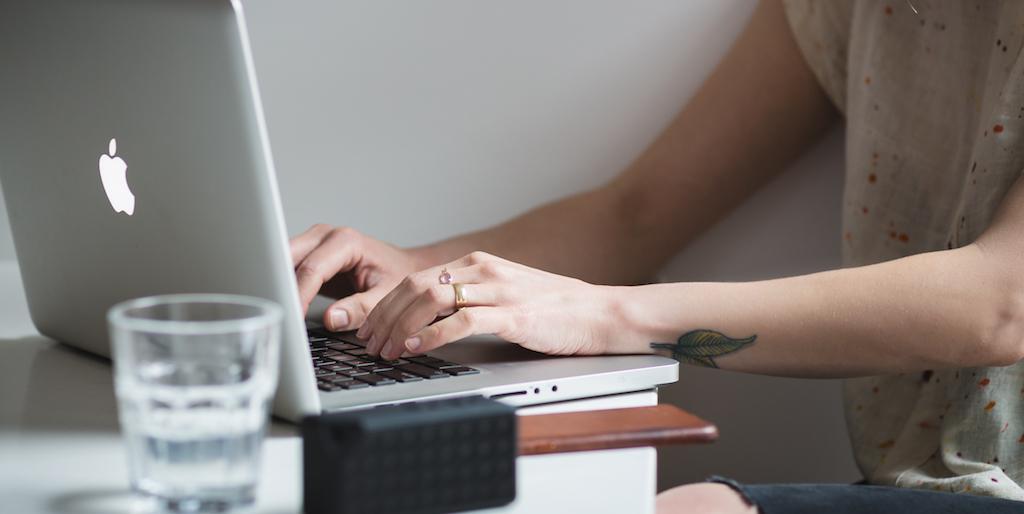 girl_typing_tattoo